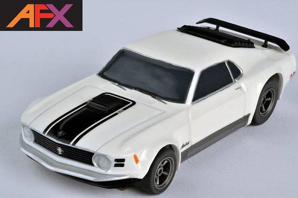 In late 1968, the Mustang Mach 1 was introduced as a 1969 model year option. AFX outfitted  this Mach 1 with the beautiful 5 spoke mag wheels from American Wheels that were so popular at the time.