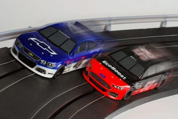 Slammed to the ground and ready to do battle, the AFX Chevy SS and Ford Fusion HO slot cars feature highly detailed NASCAR style paint schemes that are exclusive to this race set.
