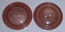 2 light burgundy plastic buttons