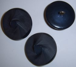 Navy blue carved swirl button