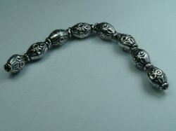 Thumbnail of GBead05 - Glinter™-Silver Substitute ellipitical round bead w/dimples