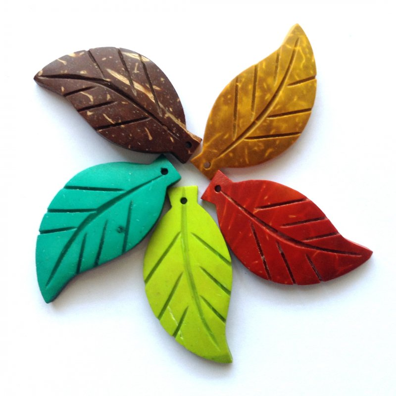 Coco Leaves, Hand Carved  Recycled from the waste of coconut palm, the coconut shell were carved into beautiful leaves. Perfect for craft and jewelry making.   Size                L = 38mm  W= 18m