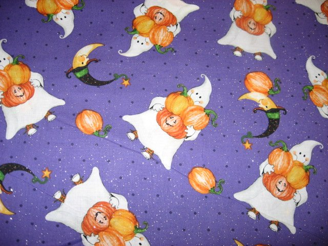 Halloween Ghosts carrying pumpkins on glittery Purple Cotton fabric by the yard
