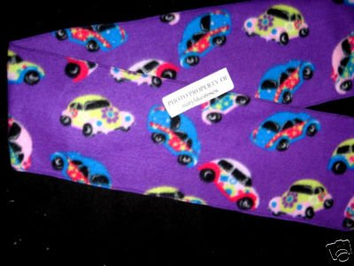 Image 0 of VW Beetle cars and peace flowers on a purple retro look fleece scarf