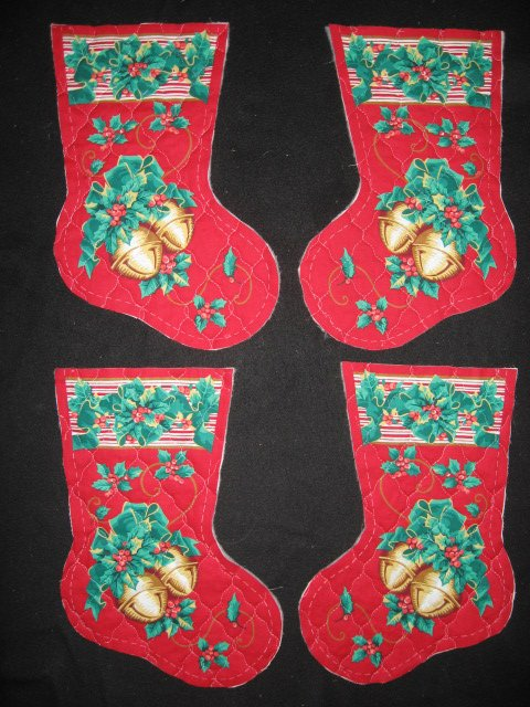 Image 0 of Jingle Bells Prequilted fabric Christmas stockings Four pieces to sew