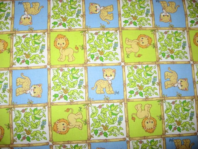 Lion  Precious Moments blue and green squares fabric by the yard