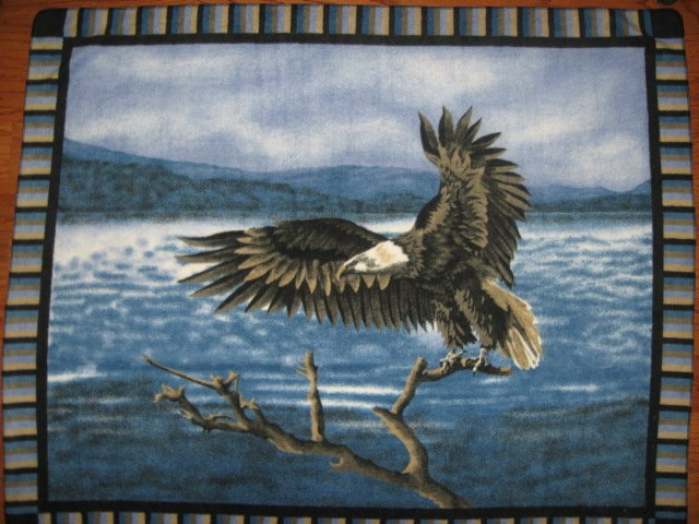 Eagle bird landing in the tree Fleece Blanket