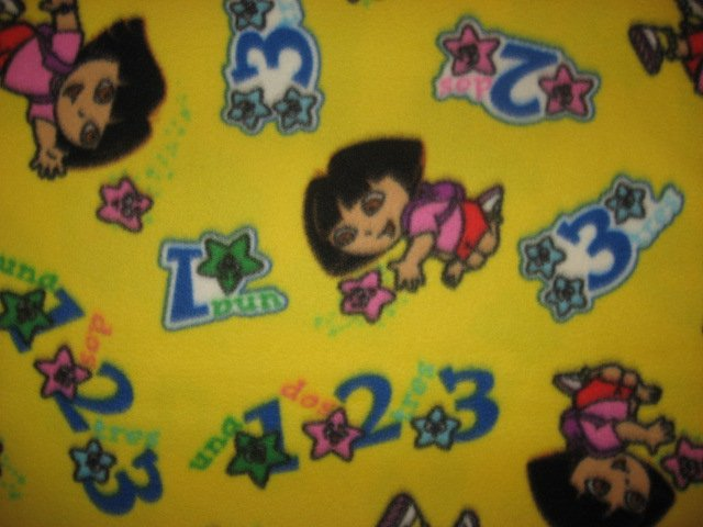 Image 0 of Dora and numbers with Spanish words yellow Child Bed size Fleece Blanket Throw