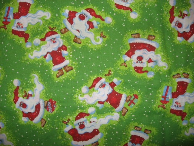 Santas with birds in the snow whimsical green Christmas Fabric by the yard