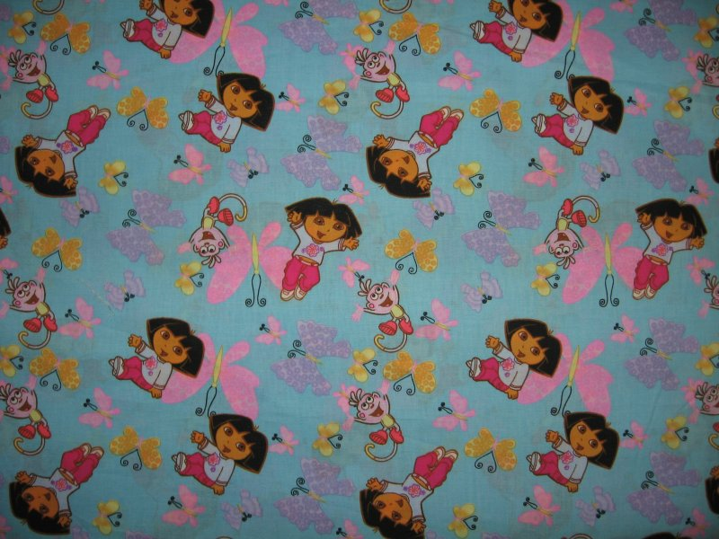 Dora Boots the monkey and stars and butterflies Blue Sewing Fabric by the yard