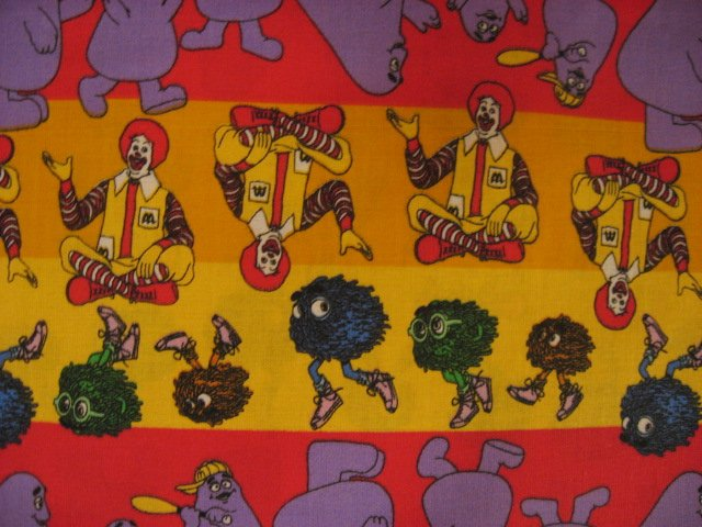 Ronald mcdonald grimace stripes cotton fabric by the yard for Solar system fleece fabric