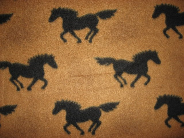 Black horses running on brown fleece by the yard to make a tie blanket or sew