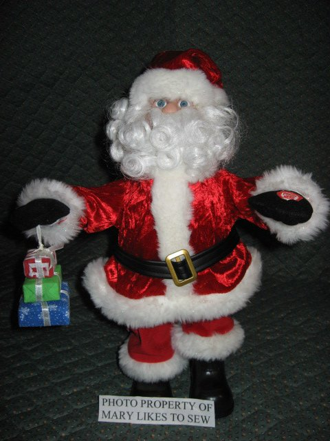 Image 1 of Christmas Santa doll from Dillards sings and walks forward and backward to music