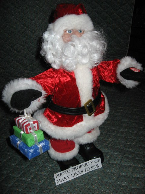 Image 0 of Christmas Santa doll from Dillards sings and walks forward and backward to music