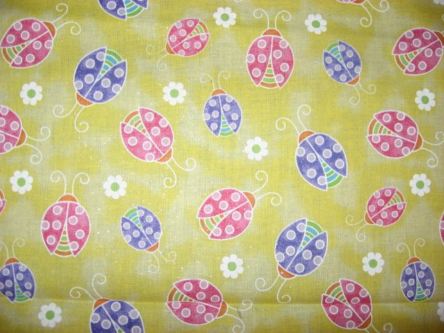Image 0 of Multicolored Ladybugs on Yellow Glittered cotton Fabric by the yard