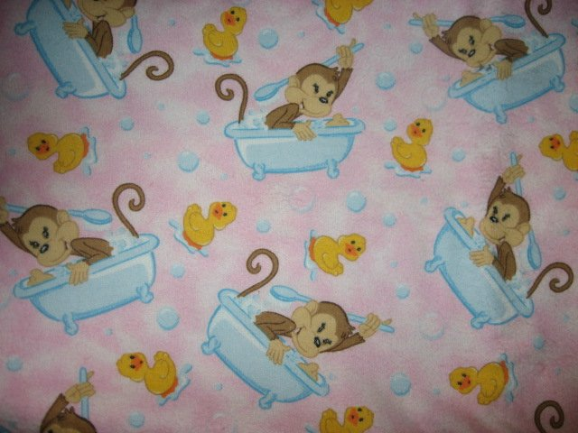 Monkey scrubbing in the bath tub flannel baby blanket