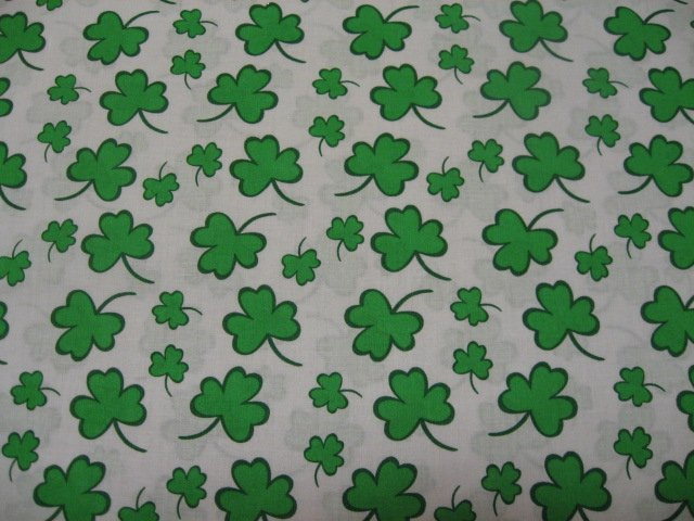 St patrick 39 s day shamrocks on white cotton quilt fabric to sew for Solar system fleece fabric