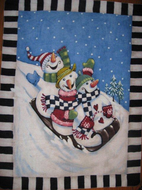 Snowmen on a toboggan fleece blanket