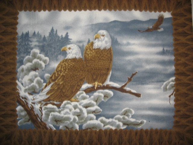 Eagles sitting in a snowy tree Fleece Blanket