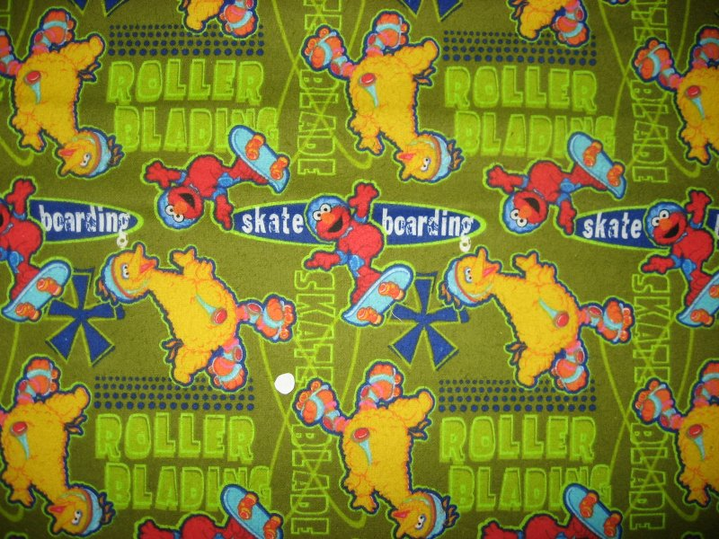 Sesame Street Big Bird and Elmo Skateboard and Rollerblade flannel Cotton fabric
