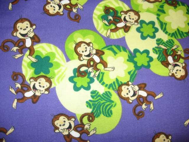Happy Monkeys and flowers on a purple Flannel baby blanket