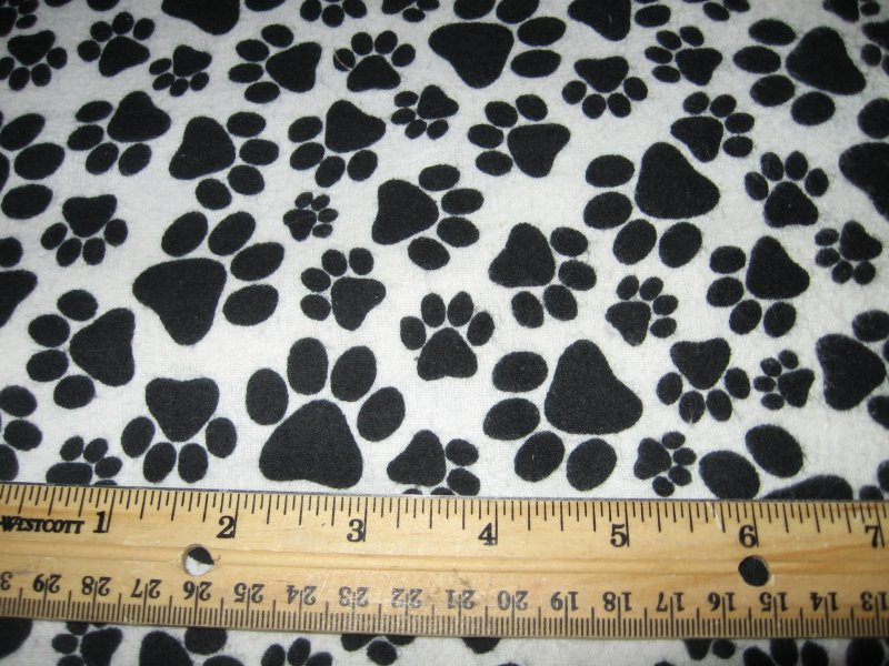Baby or dog double flannel blanket black puppy paw prints
