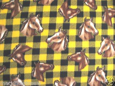 Horse heads yellow and black plaid fleece blanket