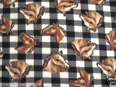 Horses on a black and white plaid fleece blanket