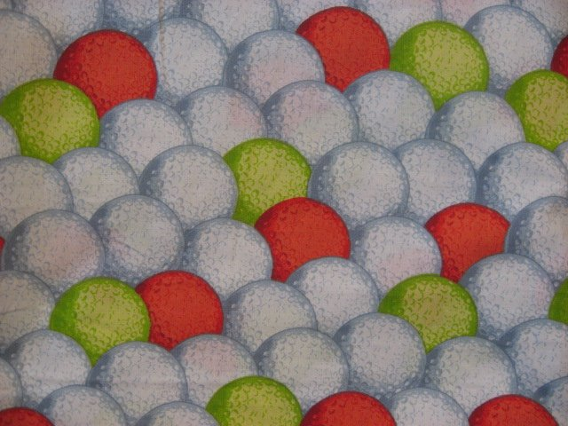 Daisy Kingdom Neon green, orange and white golf balls on 100% cotton fabric
