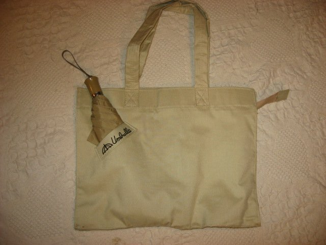 Ladies Soft tan canvas cloth bag carrying case and umbrella /
