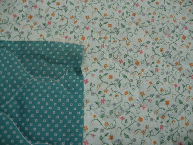 Flowers and vines on double faced light green Quilted floral Fabric to Sew