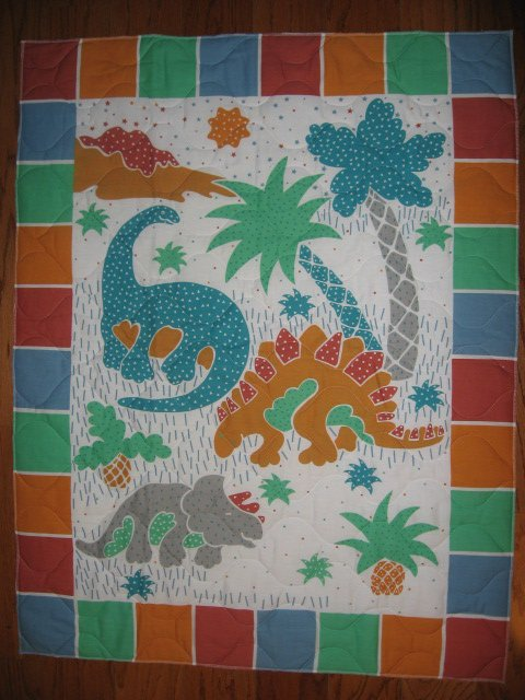 Image 0 of Whimsical dinosaurs crib quilt fabric panel finished edges