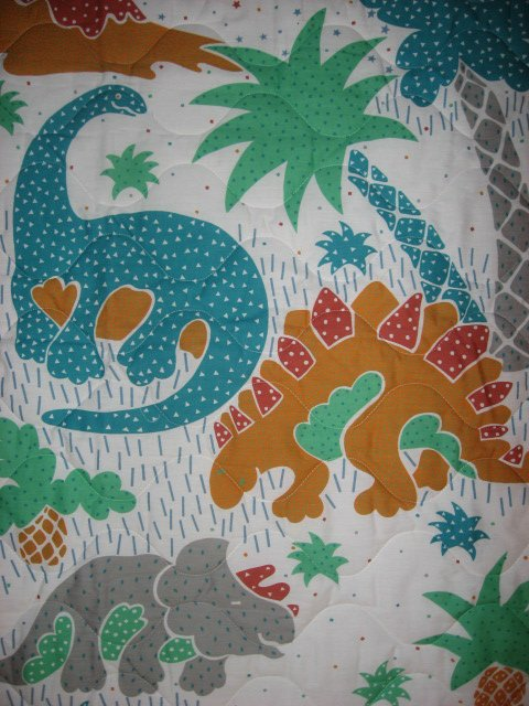 Image 1 of Whimsical dinosaurs crib quilt fabric panel finished edges