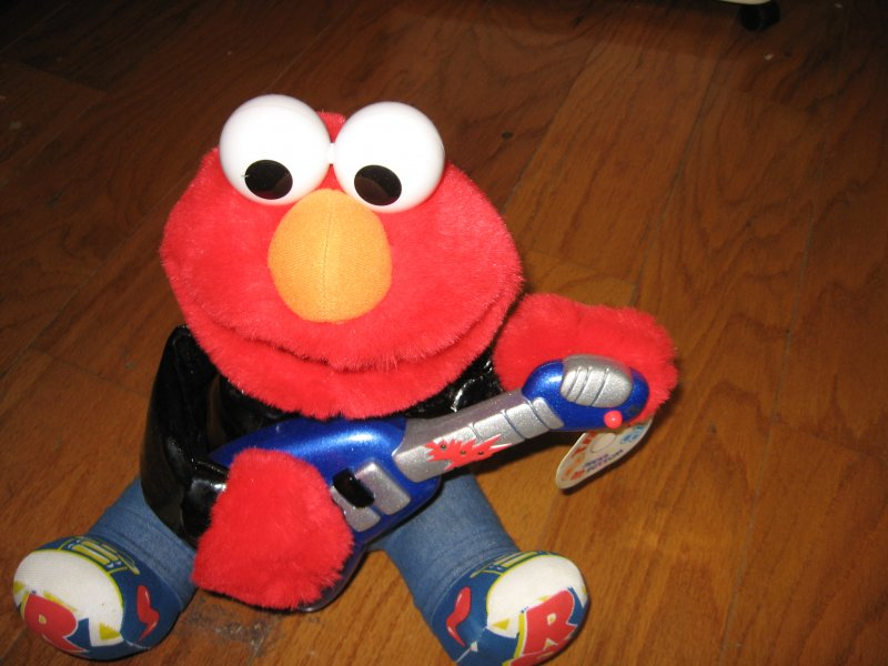 Image 0 of Sesame Street 1998 Rock and Roll Elmo plays guitar music vibrates