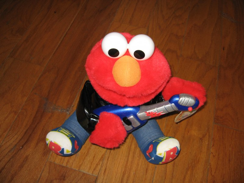 Image 1 of Sesame Street 1998 Rock and Roll Elmo plays guitar music vibrates