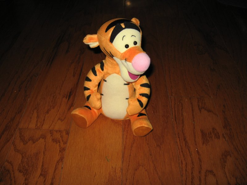 Tigger Disney talks and talks doll gently used