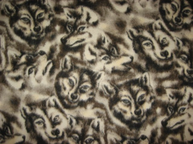 Image 1 of Wolf Wolves Wild Dog Faces fleece by the yard to make a tie blanket or sew