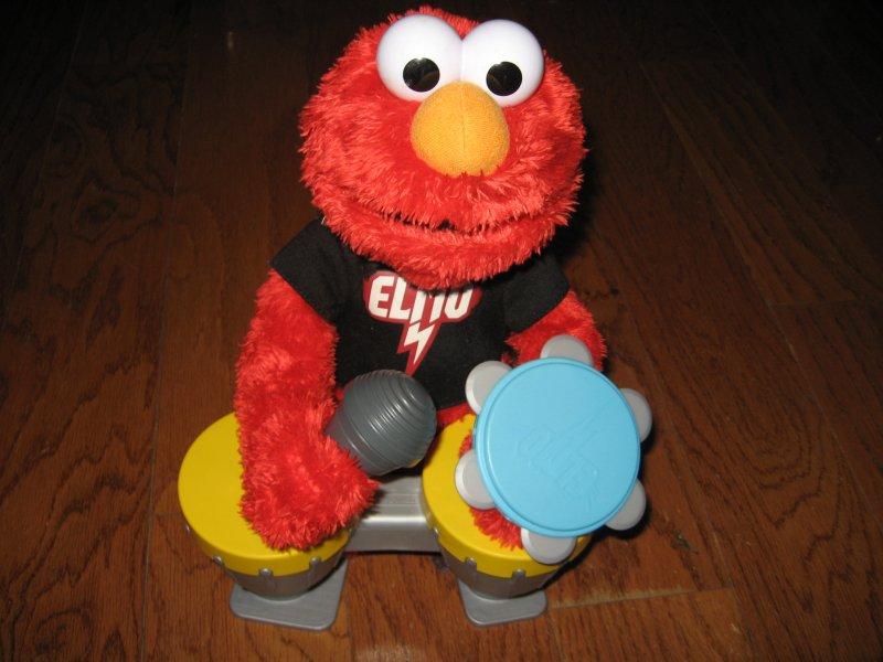 Image 1 of Sesame street Elmo Hasbro doll talks sings drums microphone castanet