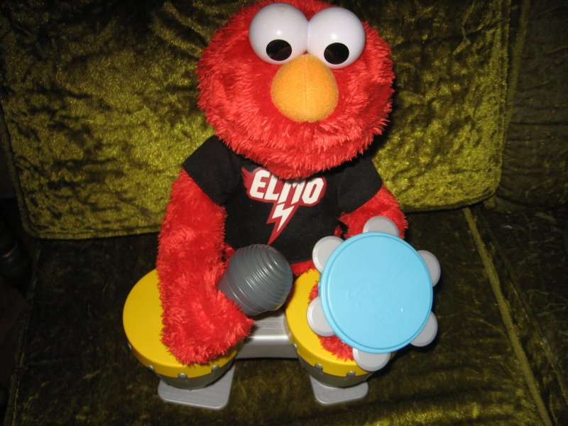 Sesame street Elmo Hasbro doll talks sings drums microphone castanet