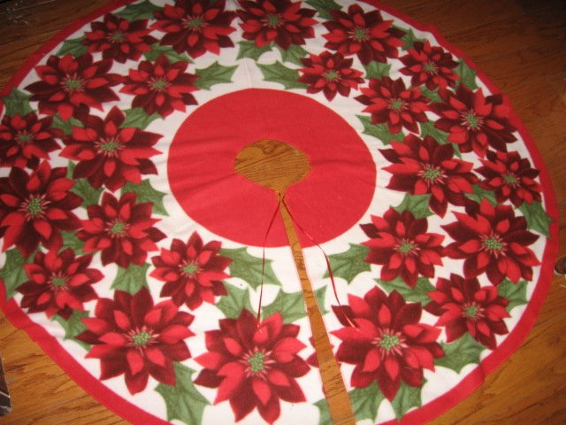 Poinsettia Fleece Christmas tree skirt finished surged edge satin tie