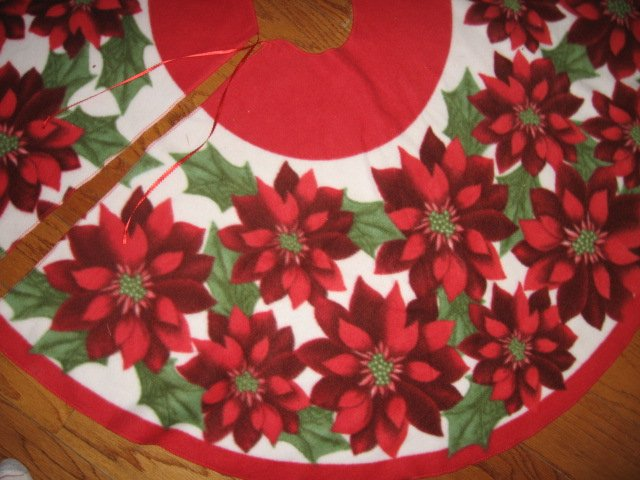 Image 1 of Poinsettia Fleece Christmas tree skirt finished surged edge satin tie