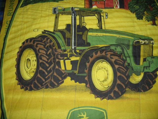 Image 1 of John Deere Tractor extra thick comforter 48 inches by 84 inches