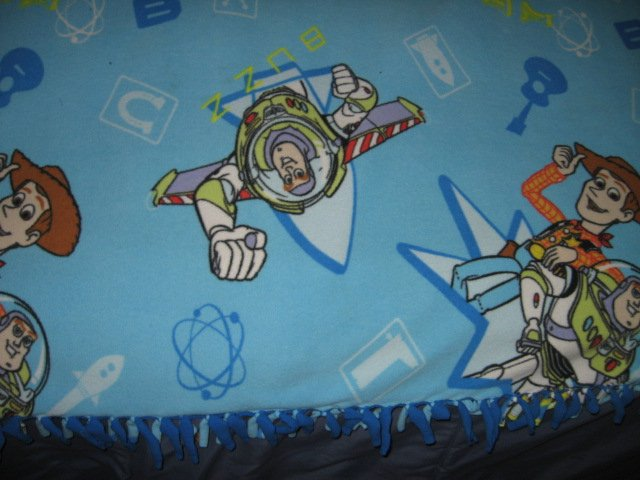 Image 1 of toy story double sided Fleece Blanket tied edges 42 inch by 52 inch