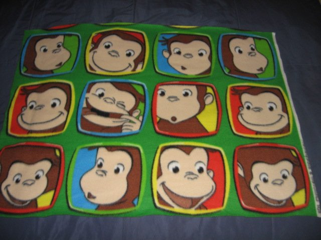 Image 0 of Curious George faces Licensed handmade baby or toddler fleece blanket 24