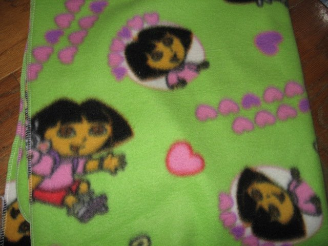 Image 0 of Dora and monkey green  baby blanket Handmade with licensed fleece