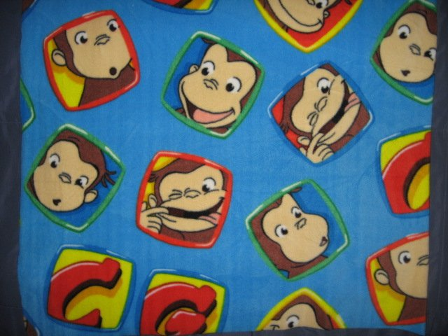 Curious George Faces fleece blue toddler blanket 30 inch by 36 inch