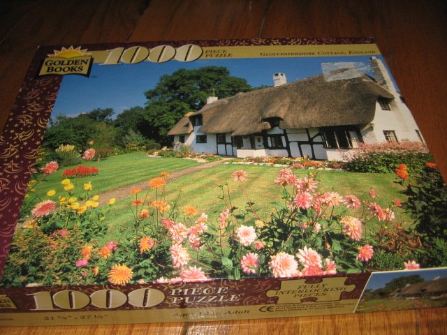 Image 0 of Cottage Gloucestershire England 1000 piece puzzle 21 X 27 inches