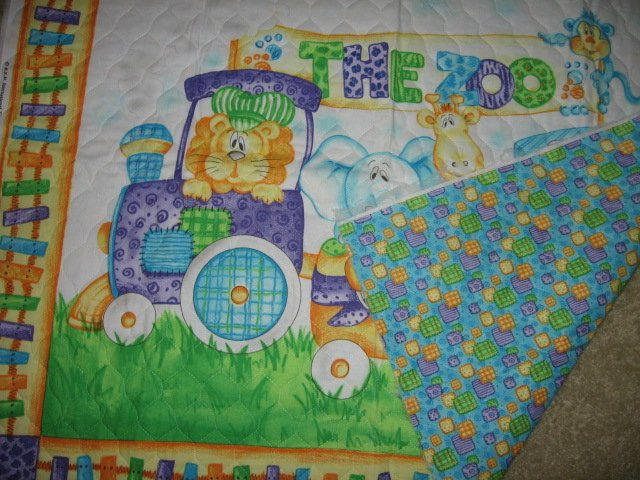 Image 1 of Zoo wagon train baby animals lion elephant hippo quilt 42 X 35 inch