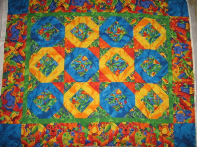 Image 0 of Jungle collage  baby animals matching border quilt 42 X 35 inch