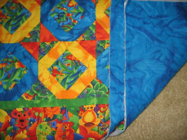Image 1 of Jungle collage  baby animals matching border quilt 42 X 35 inch